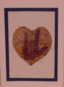 """I Love You"" greeting card created using  maple and redbud leaves."